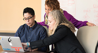 Image of Teacher helping students with their job search