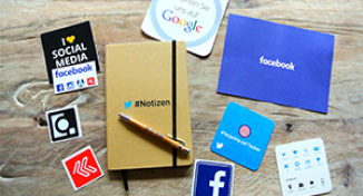 Image of Pieces of paper advertising Facebook, Twitter and Google